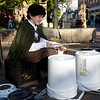 HADLEY GREEN/ Staff photo<br /> Mason Bergeron of Whitman, dressed as Frodo Baggins, tries his hands on street performer Joshua Rodriguez's drums while celebrating Halloween in Salem.<br /> <br /> 10/30/2018