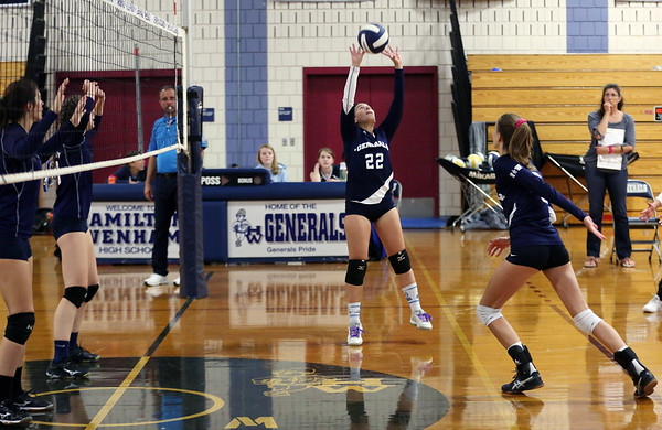 HADLEY GREEN/ Staff photo<br /> Hamilton Wenham's Emma Day (22) jumps to set the ball to Peabody at the girls volleyball game at Hamilton Wenham high school. <br /> <br /> 10/08/2018
