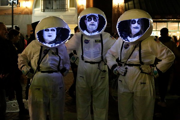 HADLEY GREEN/ Staff photo<br /> Sabina Yi of Baltimore, Joe Hallinan of Salem and Katie Labonte of Salem are glow in the dark astronauts on Halloween night in Salem.<br /> <br /> 10/30/2018