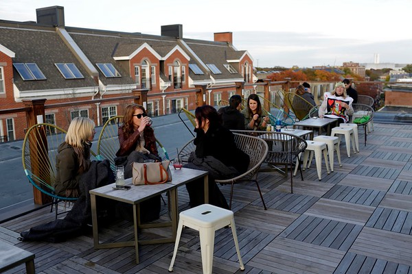 HADLEY GREEN/ Staff photo<br /> Guests enjoy an aerial view of Salem from Hotel Salem's rooftop bar on Halloween night.<br /> 10/30/2018