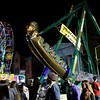 HADLEY GREEN/ Staff photo<br /> People ride the Pharaoh's Fury and ferris wheel at the carnival on Halloween night in Salem.<br /> <br /> 10/30/2018