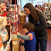 HADLEY GREEN/ Staff photo<br /> Claire Wheadon of Marblehead and her son, Dave, taste a sample at Shubie's in Marblehead.<br /> <br /> 10/16/2018