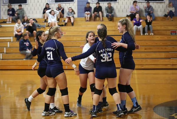 HADLEY GREEN/ Staff photo<br /> Peabody players celebrate after scoring a point in their game against Hamilton Wenham at Hamilton Wenham high school. <br /> <br /> 10/08/2018