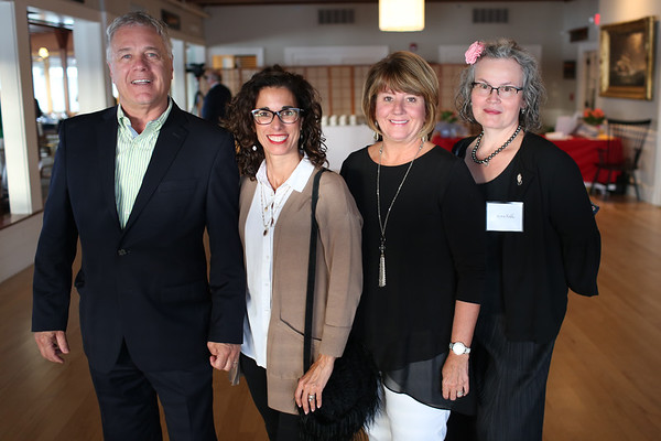 HADLEY GREEN/ Staff photo<br /> From left, George Barbuzza of Lafayette Rehab, Nadine Simon of Lafayette Rehab, Lauri Lachance and Nora Falk of Marblehead attend the Marblehead Chamber of Commerce annual meeting and community awards at the Corinthian Yacht Club in Marblehead.<br /> <br /> 09/21/2018