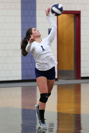 HADLEY GREEN/ Staff photo<br /> Peabody's Tatiana Correia (1) serves to Hamilton Wenham during the girls volleyball game at Hamilton Wenham high school. <br /> <br /> 10/08/2018