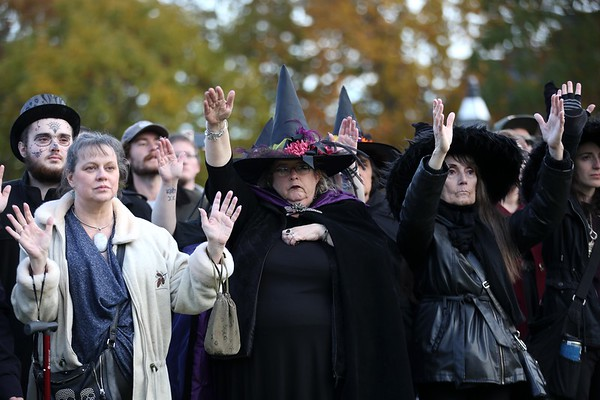 HADLEY GREEN/ Staff photo<br /> Participants of the Salem Witches' Magic Circle call upon ancestors during the Halloween ceremony on Salem Common.<br /> <br /> 10/30/2018