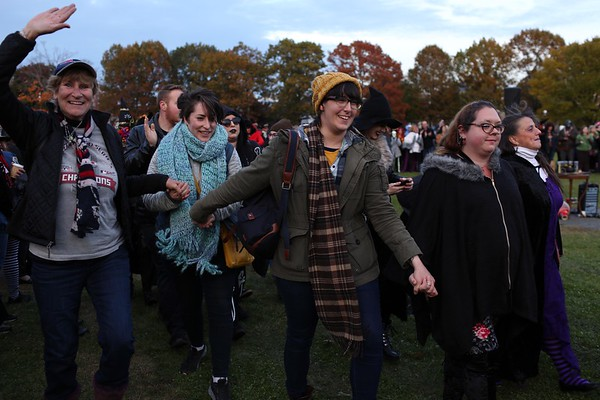 HADLEY GREEN/ Staff photo<br /> Participants of the Salem Witches Magic Circle dance during the ceremony to celebrate those who have passed on Salem Common on Halloween night.<br /> <br /> 10/30/2018