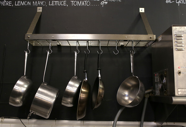 HADLEY GREEN/ Staff photo<br /> Cooking pots and pans hang on the wall at Shubie's in Marblehead.<br /> <br /> 10/16/2018