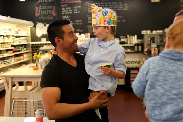 HADLEY GREEN/ Staff photo<br /> Rodrigo Angel, a Shubie's sales associate, greets customer and birthday boy Peter Watt, 6, of Marblehead, at Shubie's in Marblehead.<br /> <br /> 10/16/2018