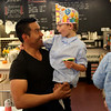 HADLEY GREEN/ Staff photo<br /> Rodrigo Angel, a Shubie's sales associate, greets customer and birthday boy Peter Watt, 6, of Marblehead, at Shubie's in Marblehead.<br /> <br /> 10/16/2018