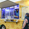 Owner Romain Price of the Cheese, Please food truck serves a customer as he is parked right next to the Beverly Bootstraps store in Beverly. <br /> <br /> JAIME CAMPOS/Staff photo 10/1/2020