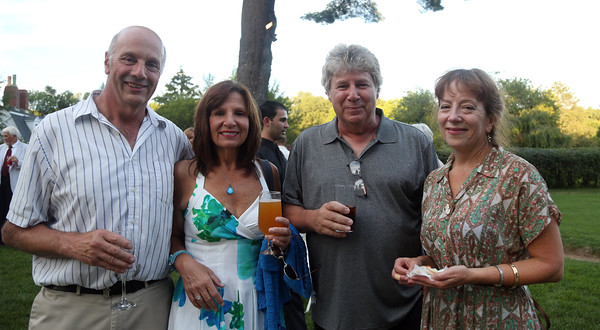 DAVID LE/Staff photo. From left, Charlier Forster, Jean Avallon, Paul Gareri, and Laura Illey, at the Danvers Historical Society's September Swings event held at Glen Magna Farms on Friday evening. 9/9/16.