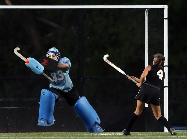 DAVID LE/Staff photo. Danvers goalie Julie Webster (33) makes a save on Beverly's CC Collins' penalty shot on Tuesday evening. 9/13/16.