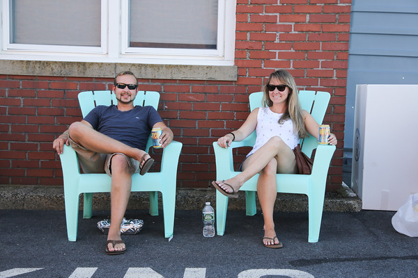 Photo/Reba Saldanha Peabody residents Eric Cronin and Beth Manning relax in the the beer garden at the international festival in Peabody Square Sunday Sept 11, 2016.