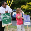 KEN YUSZKUS/Staff photo.  Rob Cooley and Sharon Gould wave to voters arriving at the Kiley Brothers Memorial School in Peabody.    09/08/16