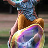 KEN YUSZKUS/Staff photo   Gwynn Benenson, 2, is held by babysitter Ruthie Cleary, while she reaches out to pop large soap bubbles created by Mark Pietkiewicz at Dane Street Beach in Beverly.      09/07/16