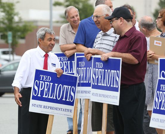 KEN YUSZKUS/Staff photo  State representative Ted Speliotis, left, chats with supporters outside the polling place at Danvers High School .    09/08/16