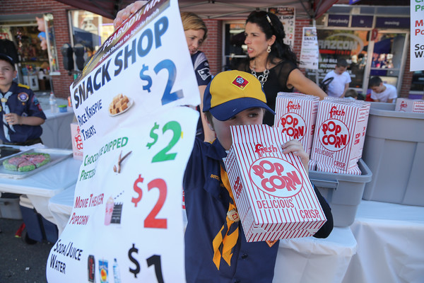Photo/Reba Saldanha Owen Casey, 7, samples the snacks at the cub scout booth during the international festival in Peabody Square Sunday Sept 11, 2016.