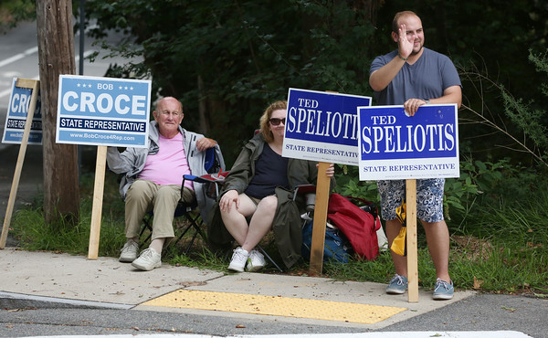 KEN YUSZKUS/Staff photo.  Greeting voters arriving at the West Memorial School in Peabody are from left, Joe Finegan, Carla Moran, and Tyler Carleton.    09/08/16