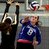 KEN YUSZKUS/Staff photo.    Danvers' Lauren McKinnon sends one back over the net during the Bishop Fenwick at Danvers volleyball match.    09/12/16