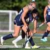DAVID LE/Staff photo. Swampscott's Micaela Freddo, left, battles for a loose ball with Peabody's Mallory LeBlanc during the first half of play on Thursday. 9/15/16.