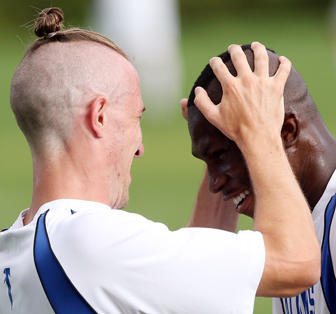 DAVID LE/Staff photo. Danvers' James McEachern, left, celebrates with teammate Sherak Ayamga, right, after Ayamga scored the first goal of the game for Danvers. 9/8/16.