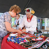 Photo/Reba Saldanha Alice Zujewski shows Helen Bielawa the Polish clothes at the international festival in Peabody Square Sunday Sept 11, 2016.