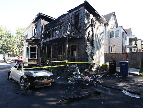 Fire scene at 13 Meadow Street in Salem.