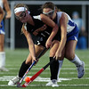 DAVID LE/Staff photo. Beverly's Meghan Cotraro (11) shields the ball from Danvers' Daria Papamechial.9/13/16.
