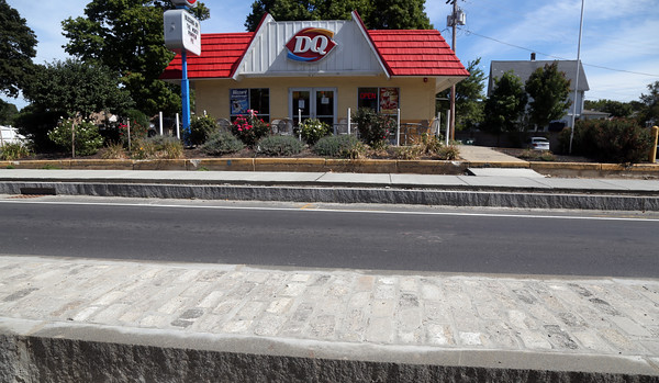 DAVID LE/Staff photo. Cobblestones that are being unearthed during the Rantoul Street project are being repurposed and used in traffic islands along the stretch of the project. This island of cobblestones is across from the Dairy Queen on Cabot Street. 9/5/16.