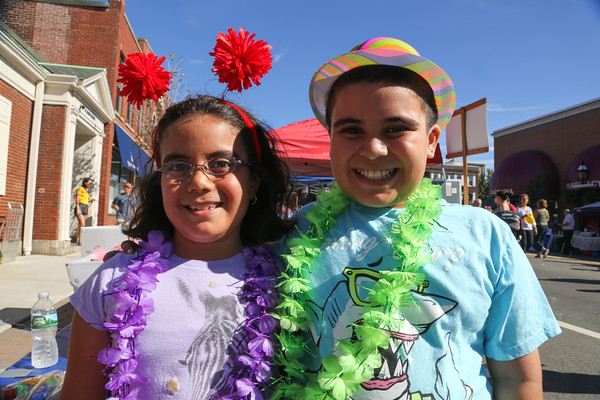 Photo/Reba Saldanha Leylah, 8 ,and Lucas 9, Hernandez of Peabody dress up for a picture in the photo booth at the international festival in Peabody Square Sunday Sept 11, 2016.
