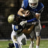 DAVID LE/Staff photo. Danvers senior captain Matt Andreas tries to break through a tackle from Winthrop senior Joe Trenouth (10). 9/9/16.