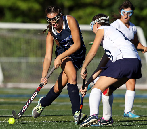 DAVID LE/Staff photo. Swampscott's Sydney Cresta plays the ball around Peabody's Sara Feinstein, right, during the second half of play. 9/15/16.