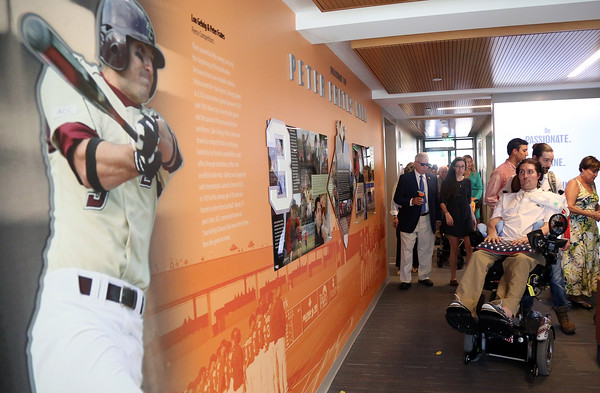 DAVID LE/Staff photo. Pete Frates, right, looks at a wall dedicated to him inside the brand new Peter Frates Hall on the campus of Endicott College in Beverly. 9/13/16.