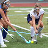 KEN YUSZKUS/Staff photo  Danvers' Ella Brinkley, left, and Peabody's Caroline O'Neil fight for possession during the Danvers at Peabody field hockey game.      09/06/16