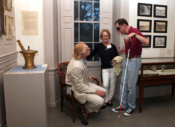 AMY SWEENEY/Staff photo.<br /> Jonathan Salt, left, talks with Linda and Daniel King, all from Beverly at the opening of a new exhibit by the Beverly Historical Society at the John Cabot House in Beverly.