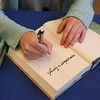 "AMY SWEENEY/Staff photo.<br /> Ashley Royer signs her book ""remember to forget"" at Barnes & Noble in Peabody during a book signing."