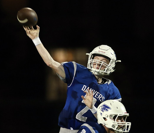 DAVID LE/Staff photo. Danvers quarterback Justin Mullaney (2) fires a pass deep downfield against Winthrop. 9/9/16.