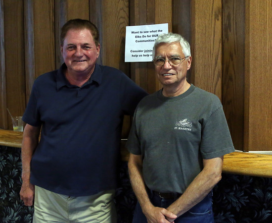 DAVID LE/Staff photo. Carl Curley, left, and Joe Faletra, at a first responders appreciation dinner held at the Peabody Elks Lodge. 9/15/16.
