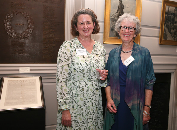 AMY SWEENEY/Staff photo.<br /> Peggy Wishart, assistant director for collections and exhibits of the Beverly Historical Society with Joan Johnson. <br /> The opening of a new exhibit by the Beverly Historical Society at the John Cabot House in Beverly.