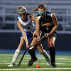 DAVID LE/Staff photo. Beverly's Noelle Matthews, right, tries to turn with the ball while being pressured by Danvers' Riley Doyle (2). 9/13/16.