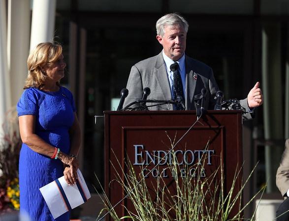 DAVID LE/Staff photo. John and Nancy Frates make remarks at a dedication ceremony for Frates Hall on the campus of Endicott College.9/13/16.