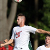 DAVID LE/Staff photo. Masco senior captain Josh Polakiewicz wins a header against Pentucket. 9/20/16.