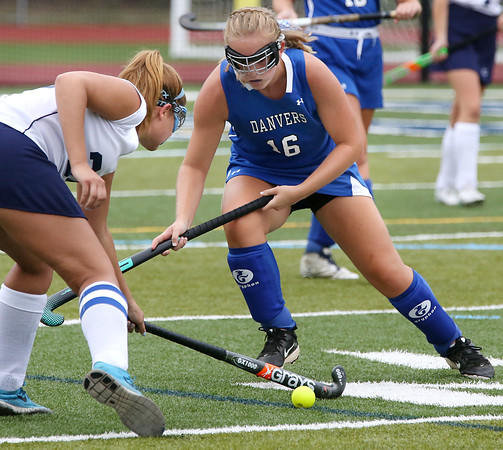 KEN YUSZKUS/Staff photo   Peabody's Taylor Colella, left, gets to the ball first before Danvers' Bella Silva during the Danvers at Peabody field hockey game.      09/06/16