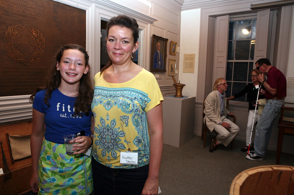 AMY SWEENEY/Staff photo.<br /> Kennedy Steiner, 12, with her mother Heather Steiner. Kennedy is the youngest volunteer at the Beverly Historical Society at the opening of a new exhibit by the Beverly Historical Society at the John Cabot House in Beverly.