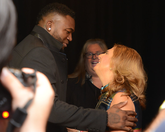"""RYAN HUTTON/ Staff photo<br /> Nancy Frates, right, is greeted by Red Sox great David Ortiz, left, in the State Street Pavilion at Fenway Park on Monday night for an event to support the book about Nancy's son Pete called the  """"The Ice Bucket Challenge"""" - a chronicle of his struggles with ALS and how he helped start the famed ice bucket challenge to raise money for ALS research."""