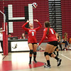 HADLEY GREEN/Staff photo<br /> Salem's Emily Nikolopolos (9) prepares to return the ball at the Salem High v. Peabody High girls varsity volleyball game held at the Salem High School field house.<br /> <br /> 09/06/17