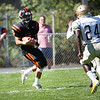 HADLEY GREEN/Staff photo<br /> Beverly's Pat Parsons (5) catches a pass from teammate Nick Berry to make a touchdown at the Beverly v. Malden boys varsity football game held at the Hurd Stadium in Beverly. <br /> 09/23/17