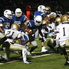HADLEY GREEN/Staff photo<br /> Danvers' Tahg Coakley (7) barrels through Malden defenders at the Danvers v. Malden boys varsity football game at Danvers High School.<br /> 09/30/17