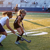 HADLEY GREEN/Staff photo<br /> Peabody's Camila DeOliveira (4) and Marblehead's Lizzy Potvin (22) vie for the ball at the Peabody v. Marblehead girls varsity field hockey game at Peabody High School.<br /> 09/26/17